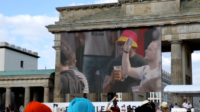 Mood on the Fan Mile at the Brandenburg Gate despite the historic defeat of the German national football team broadcast on a giant screen 2018 FIFA...