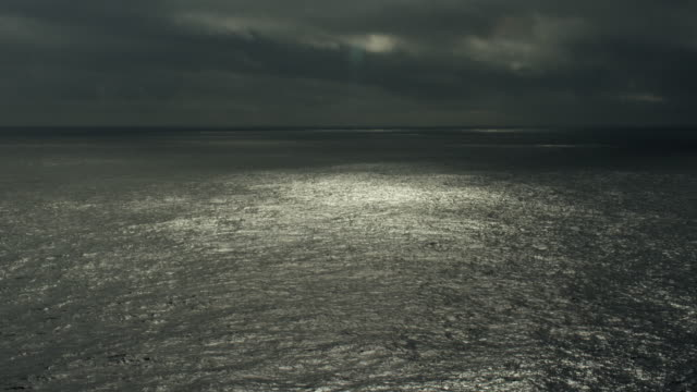 moody seascape with clouds over north pacific ocean - north pacific stock videos & royalty-free footage