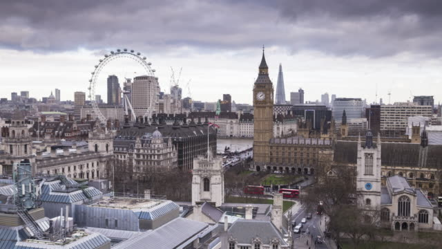 moody skies over the houses of parliament and the london eye. - flag stock videos & royalty-free footage