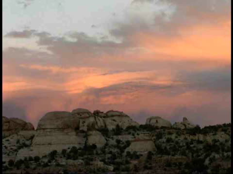 ms, moody sky above rock formations, utah, usa - stationary process plate stock videos & royalty-free footage