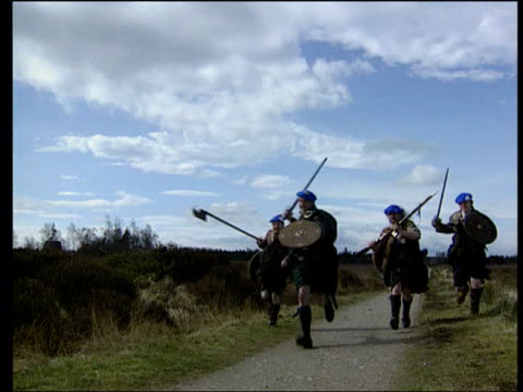 moon against the monarchy scotland invernessshire culloden men in highland dress running towards - enacting stock videos & royalty-free footage