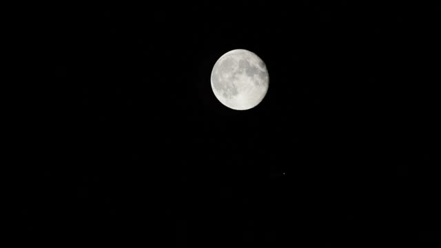 vídeos de stock e filmes b-roll de moon and jupiter appear in midnight sky on may 21 2019 in beijing china - júpiter