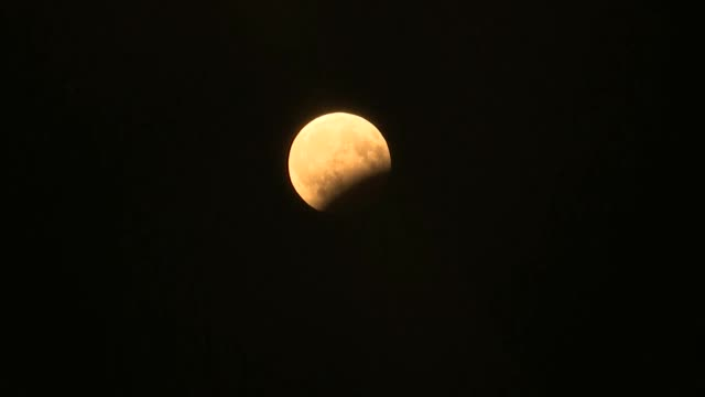 vídeos de stock, filmes e b-roll de moon during a partial lunar eclipse as seen from the turkish city of istanbul on august 07 2017 - parte de