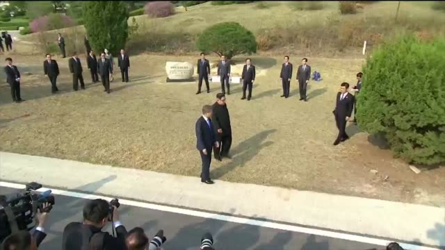 moon jaein south korea's president and kim jong un north korea's leader unveil a memorial stone in the village of panmunjom in the demilitarized zone... - south korea stock videos and b-roll footage