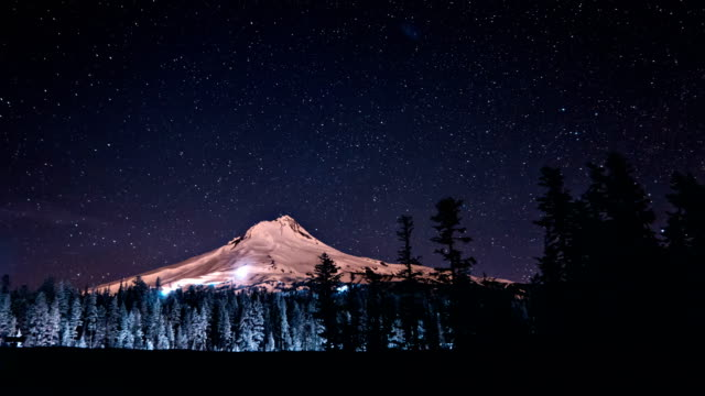 moon light illuminates mt hood oregon - mt hood stock videos & royalty-free footage