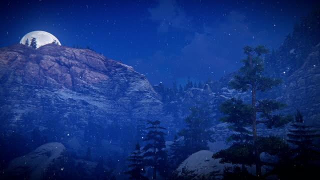 Moon over snowy mountain ridge