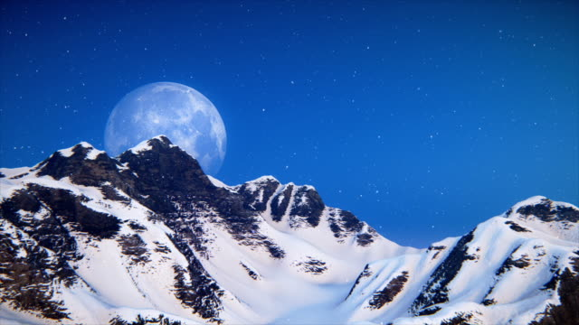 moon over snowy mountain ridge - saturated colour stock videos & royalty-free footage