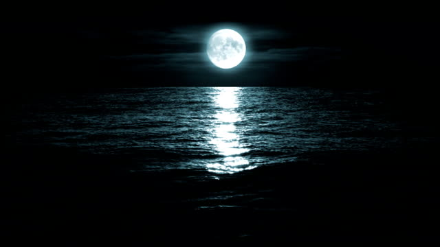 moon over the sea, loopable - moonlight stock videos & royalty-free footage