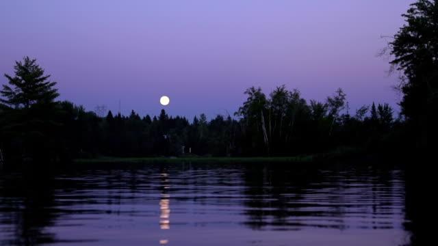 Moon reflection on a lake at sunset