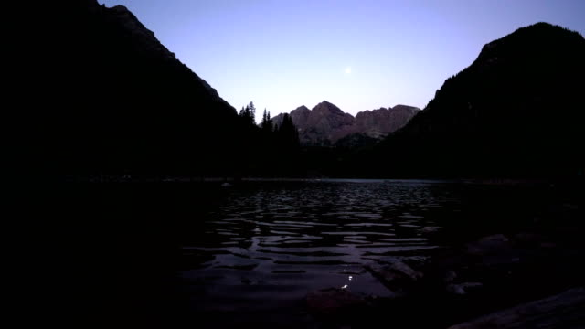 moon rise over the maroon bells before the sunrises - aspen tree stock videos & royalty-free footage