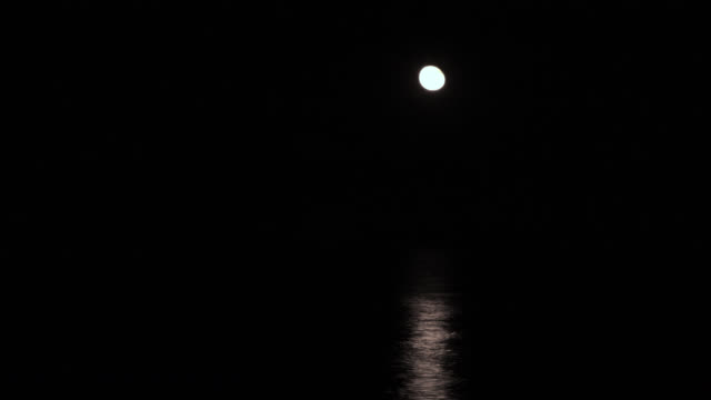 tl moon rises over sea at night, delaware, usa - moon stock videos & royalty-free footage