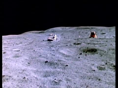 WA Moon Rover on lunar surface, lunar module in background