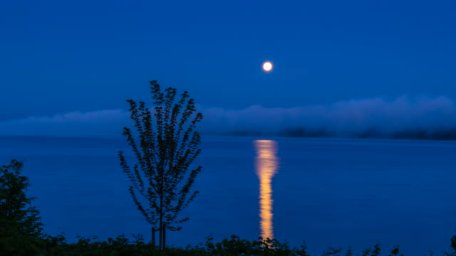 moon setting at dawn over lake starnberger see, zo - local landmark stock videos & royalty-free footage