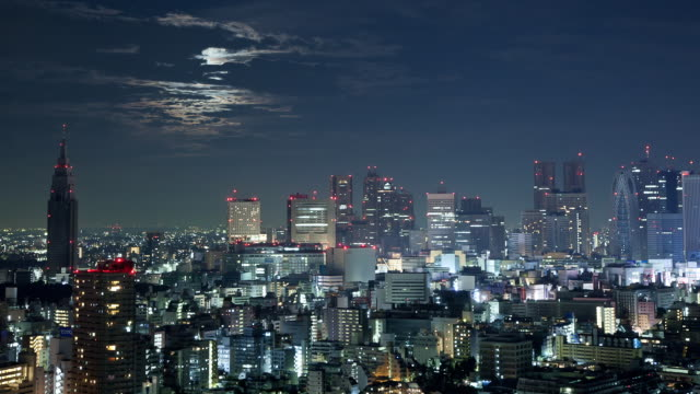 ws t/l moon setting over shinjuku business and entertainment area / tokyo, japan - wide shot stock videos & royalty-free footage