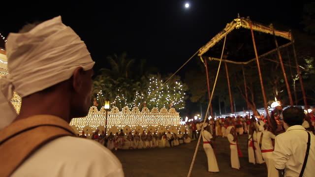 stockvideo's en b-roll-footage met ms moon shinning above buddhist festival or procession 'esala perahera', held during full moon audio / kandy, central province, sri lanka - sri lankaanse cultuur