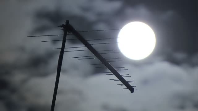 moon with clouds fast and television antenna - cathode ray tube stock videos and b-roll footage