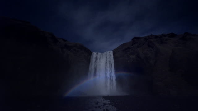 ws 'moonbow' at skógafoss waterfall, iceland - dramatic landscape stock videos & royalty-free footage