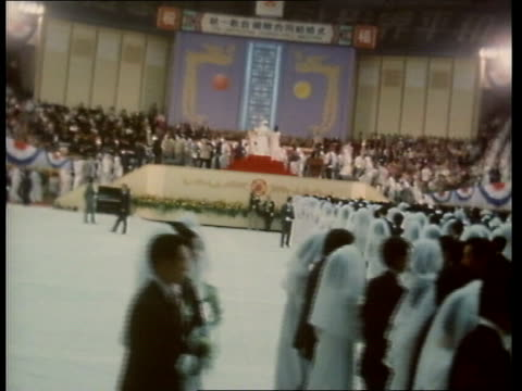 south korea pan mass couples sof wedding march ts as all move forward pull back as rev sun myung moon blesses them ms line towards gv as all move to... - stage set stock videos and b-roll footage