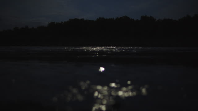 moonlight reflects off the colorado river in grand junction, colorado at night - treelined stock videos & royalty-free footage