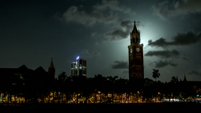 moonrise in mumbai city - bombay stock exchange building and mumbai univeristy / rajabai clock tower - clock tower stock videos & royalty-free footage