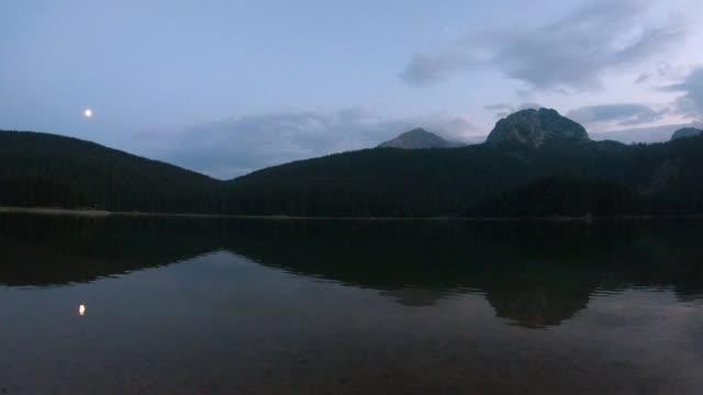 moonrise over black lake, montenegro - durmitor national park stock videos & royalty-free footage