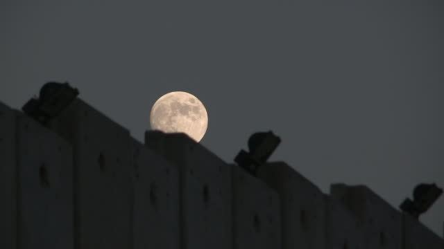 Moonrise over the Wall, Israel and Palestine