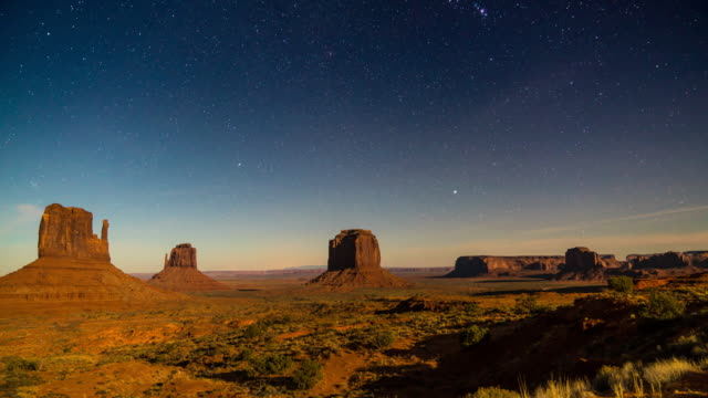moonset at monument valley - monument valley stock videos & royalty-free footage