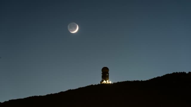 moonset over gudeok weather station in siyak mountain, seogu, busan, south korea - day stock videos & royalty-free footage
