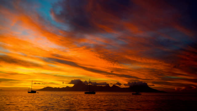 moorea island at sunset from tahiti south pacific - moorea stock videos and b-roll footage