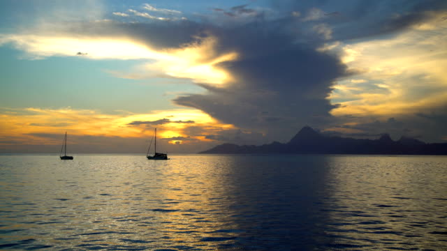 moorea island from tahiti at sunset south pacific - french overseas territory stock videos & royalty-free footage
