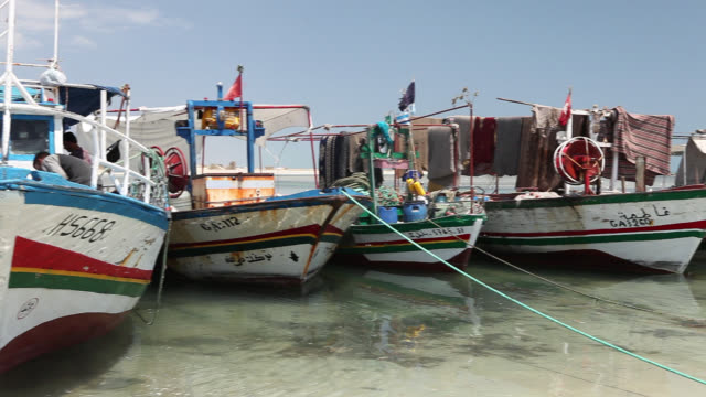 moored boats on djerba beach - tunisia video stock e b–roll
