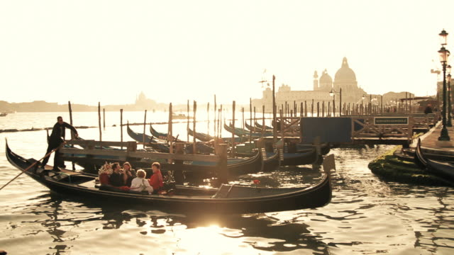 moored gondolas at sunset, venice, veneto, italy - venedig stock-videos und b-roll-filmmaterial
