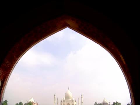 Moorish archway revealsTaj Mahal in distance Agra