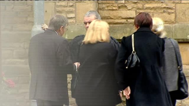 Winnie Johnson funeral ENGLAND Manchester Victoria Park St Chrysostom's Church EXT St Chrysostom's Church sign / people congregating outside church /...