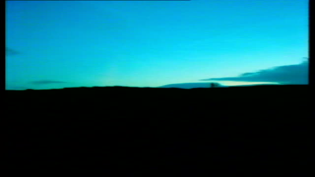 moors remains found dawn lms men stand on top rise in ground talking as in silhouette pull out airv burial area covered by tent airv ditto no cloud... - festzelt stock-videos und b-roll-filmmaterial
