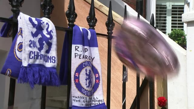 Moped mugger convicted of murder following attempt to steal a watch T19071740 / Chelsea scarves with 'RIP Pearcy written on tied to fence