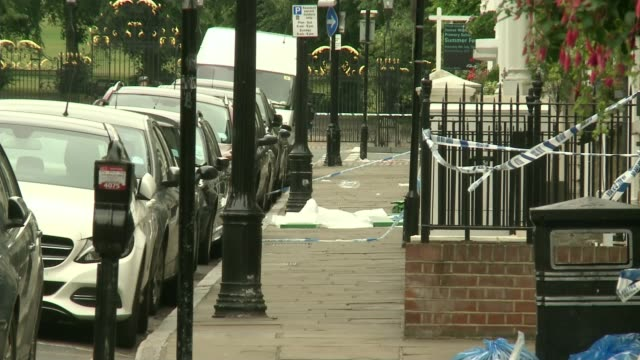 Moped mugger convicted of murder following attempt to steal a watch T150717031 / London Greenwich EXT Wide shot of police officer in cordoned off...