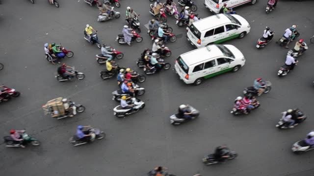 Mopeds maneuver through Ho Chi Minh City, Vietnam.
