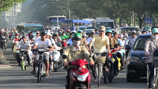 mopeds waiting at lights during rush hour in central saigon, ho chi minh, vietnam, asia - vietnam stock videos & royalty-free footage