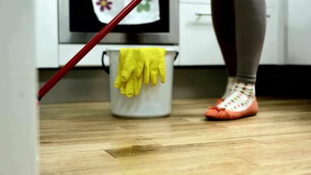 hd: mopping a floor in the kitchen - stereotypically working class stock videos and b-roll footage