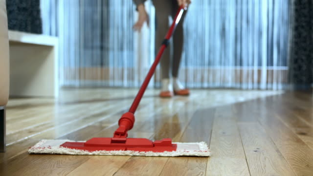 stockvideo's en b-roll-footage met hd dolly: mopping the hardwood floor - schoonmaken
