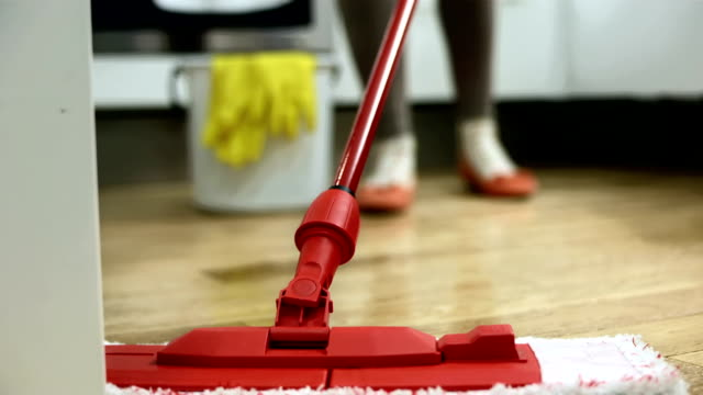 hd: mopping the hardwood floor - stereotypically working class stock videos and b-roll footage