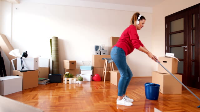 mopping the hardwood floor - mid adult women stock videos & royalty-free footage