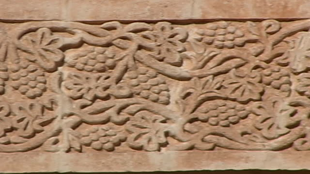 mor gabriel monastery. pan-left on grape vine details carved on monastery walls. - grape stock videos & royalty-free footage