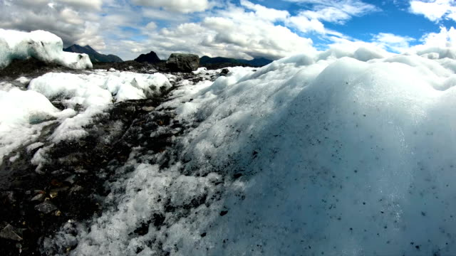 pov moraine debris in melting snow and ice - rubble stock videos & royalty-free footage
