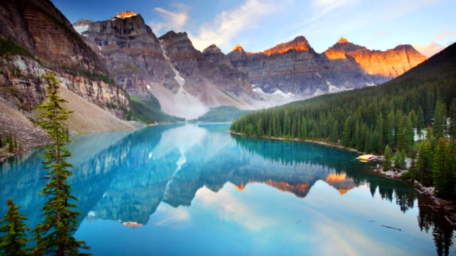 moraine lake at sunrise, banff national park, canada - banff national park stock videos & royalty-free footage
