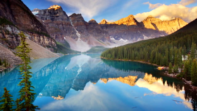moraine lake at sunrise, banff national park, canada - alberta stock videos & royalty-free footage