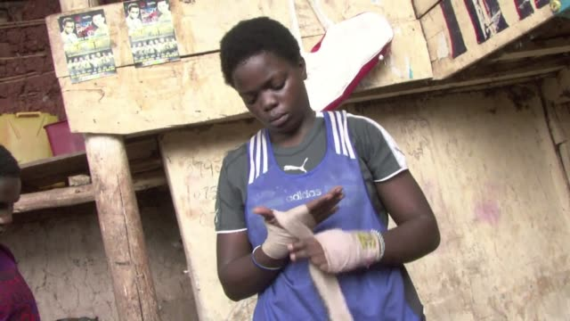 more and more women are taking up boxing in the ugandan capital as a way of learning to defend themselves against attackers. clean : ugandan women... - boxing women's stock videos & royalty-free footage