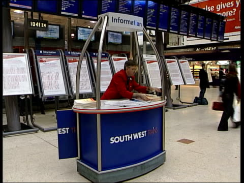 More Britons held in Guantanamo Bay ITN London Waterloo Poster warning of planned RMT strike action SIDE MS Passengers waiting around in station...