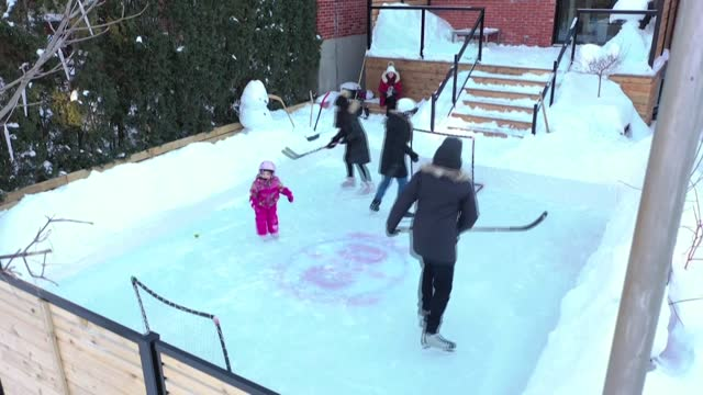 more canadians than ever this year are embracing an old winter tradition in this country, the backyard ice rink, as public health authorities have... - montréal stock videos & royalty-free footage